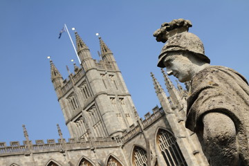 Bath Abbey and a statue at the Roman Baths