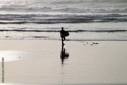 Surfer Silhouette on an Empty Beach