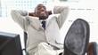 Black businessman the feet on his desk