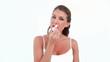 Woman applying lips balm