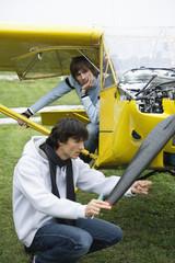 Young man repairing airplane