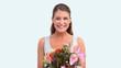 Woman smelling a flower bouquet