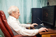 Senior Man And Computer