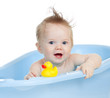 adorable baby having bath in blue tub