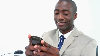 Black businessman texting on a smartphone