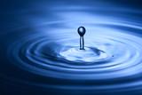 Closeup of water splash in blue tonality