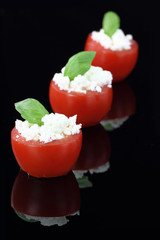 Cherry tomatoes stuffed with white cheese