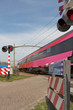 Fast train at level crossing
