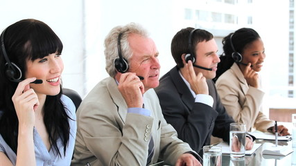 Happy business team using headsets