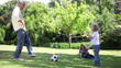 Father playing football with his children