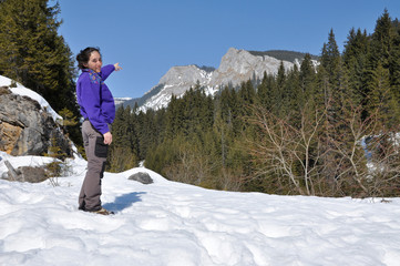 Alone trekking woman in the snowy mountains. Carpathians, Romani