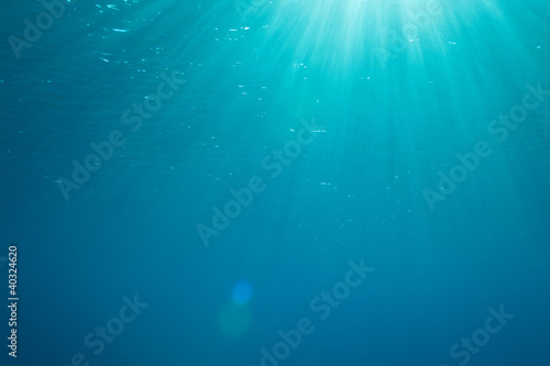 background with sunbeams underwater