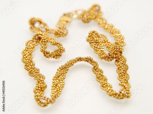 Yellow gold jewellry, isolated towards white background
