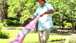 Little daughter being held by his father while turning