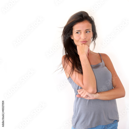Charming young woman standing on white background, isolated