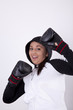 Young attractive woman with boxing gloves
