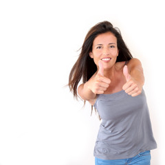 Charming young woman showing thumbs up, isolated