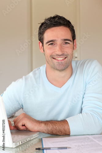 Portrait of smiling man working from home