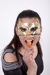 Young attractive masked woman