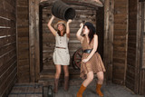 brunette and blonde CowGirls fighting in old depot