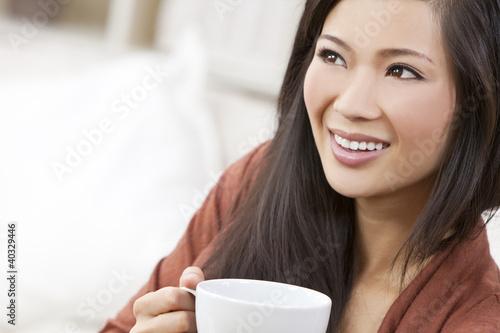 Beautiful Chinese Oriental Asian Woman Drinking Tea or Coffee
