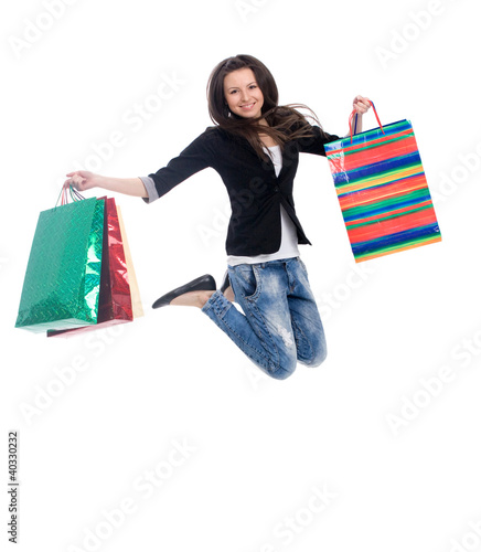 happy cute young woman  jumping with color bags