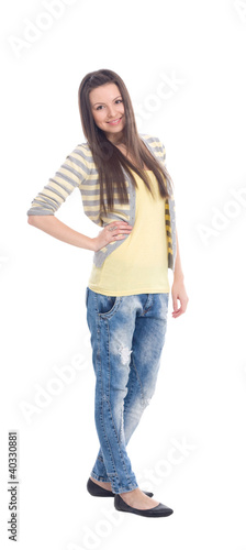 Happy young woman standing full length isolated