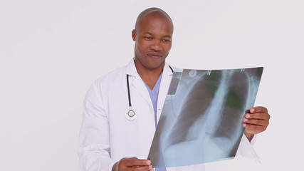 Serious practitioner holding an x-ray