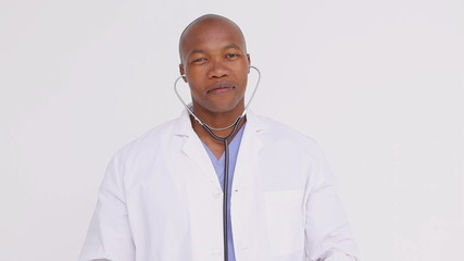 Smiling doctor proudly showing his stethoscope