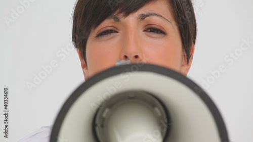 Businesswoman speaking through a megaphone