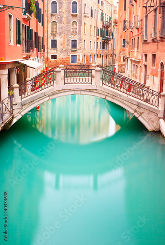 Venice, Bridge on water canall. Long exposure photography. - 40334648