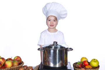 Junges Mädchen berüßt Sie beim kochen