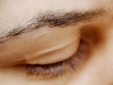 Close up of a womans eye brow poster