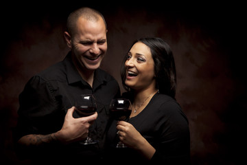 Happy Mixed Race Couple Holding Wine Glasses