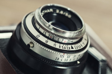 Lens and exposure controls of vintage camera.