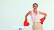 Businesswoman hitting a laptop with boxing gloves