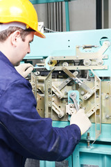 machinist with spanner adjusting lift mechanism