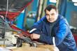 happy mechanic technician at service station