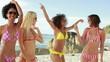 Four women wearing sunglasses partying in their bikinis