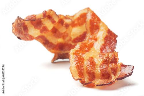 Leinwanddruck Bild Fried bacon isolated on white