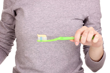 Toothbrush with paste in hand isolated on white