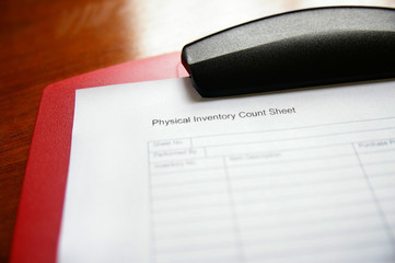 Business inventory tracking sheet on a clipboard