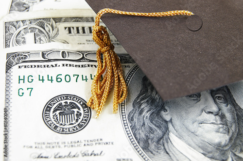 mini graduation cap on money