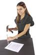 Metaphor businesswoman nails contract agreement