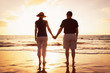 Senior Couple Enjoying Sunset at the Beach