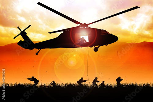 Leinwanddruck Bild Helicopter is dropping the troops