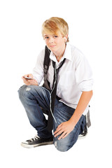 teenager boy with cell phone or mp3 player