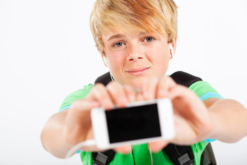teen boy holding a smart phone towards camera