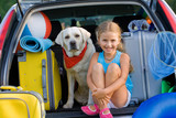 Travel, lovely girl with dog ready for family travel