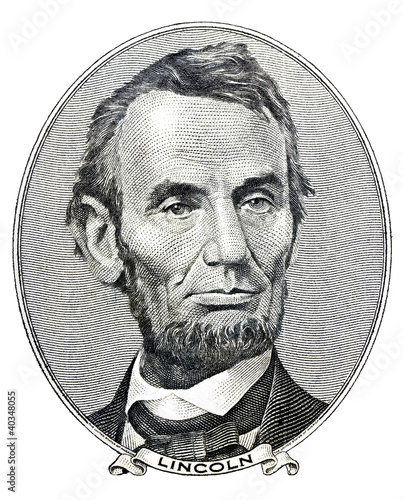 president Abraham Lincoln as he looks on five dollar bill